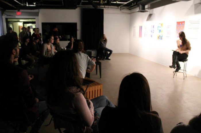 Rachel Kennedy reading at one of Winters' College's poetry nights at EWAG (Eleanore Winters Art Gallery)
