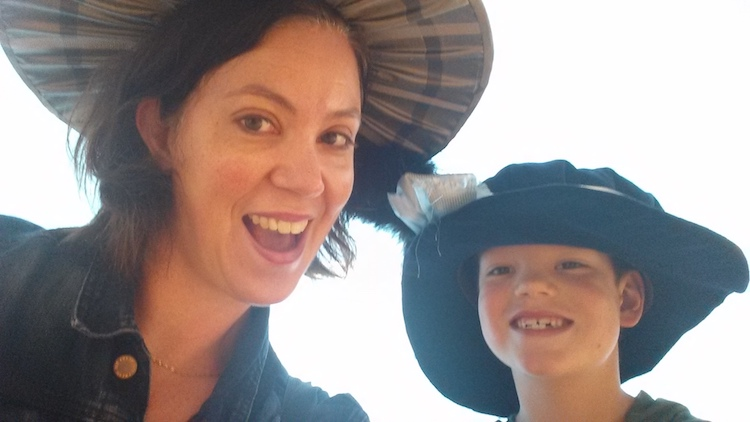 Marlis and her son, Isaac (then 7), in Stoke-on-Trent at a museum trying on Downton Abbey-style hats!